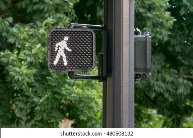 Signal letting the pedestrian know it's okay to walk