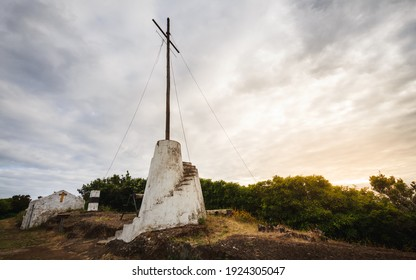 Signal post with its corresponding signalman's shelter, located on one of the peaks of Monte Brasil, Angra do Heroísmo, Ilha Terceira, Azores, Portugal. Formerly spheres were hung from that cross to f