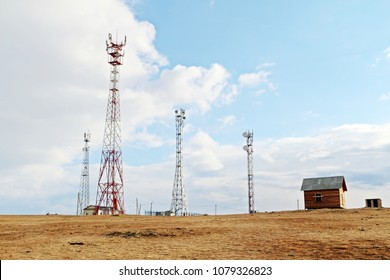 Signal towers with satellite dish for telecommunication in suburb or remote area located on top of mountain