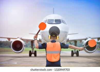 signal vest Aircraft. Airport officials are signaling the landing of the aircraft.