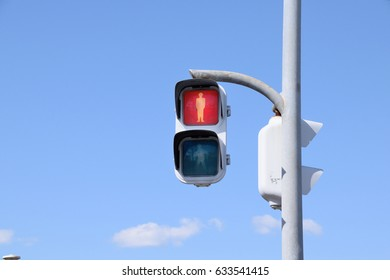 Signals for pedestrians in Japan. The red light means stop.