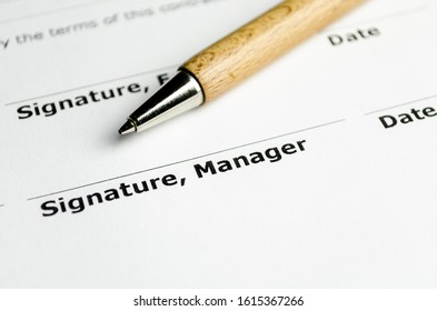 Signature manager contract with wooden pen