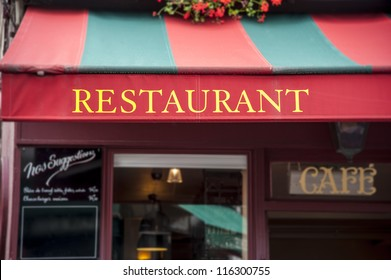 Signboard by entrance in restaurant. Paris. France