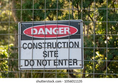 Signboard of danger at construction site.
