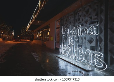 Signboard with the inscription Neringa greeting, from LED lighting, in Lithuania in the city of Nida