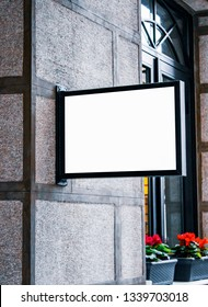 Signboard mockup and template empty frame for logo and text on the city wall  background