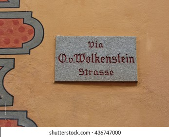 Signboard with name of the street in the center of Castelrotto (Kastelruth) - the town is a gateway to the Alpe di Siusi, the largest high Alpine meadow in Europe, and the rugged Dolomites mountains