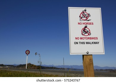 Signboard of No Horses No Motorbikes on the Walkway