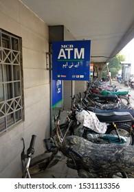 Signboard showing MCB bank atm at west wharf road Karachi , Sindh Pakistan - sep 2019