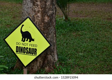 signboard with statement  do not feed dinosaur