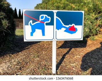 Signboard with symbol of clean up after your dog poop, warning sign.