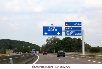 signboards in the highway of France and the indication to go to Paris many french cities such auxerre city, dijon city, pouilly en auxois city