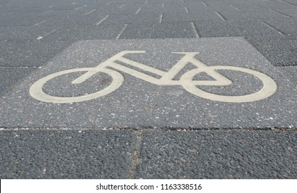 Signed bicycle symbol on the way as a marker for bike path