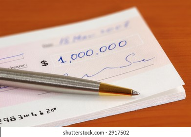 Signed one million dollars cheque and a pen