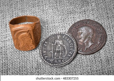 signet ring and two coins of the ancient Roman Empire.