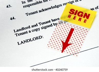 The sign-here sticker on the rental contract