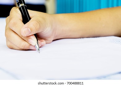 Signing a business contract for proof of agreement, The beginning of a good future Progressive prosperity of life, Black luxury pen holder To write on the document.