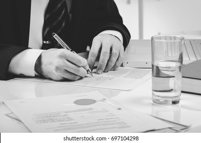 Signing contract. Lawyer or notar on his workplace