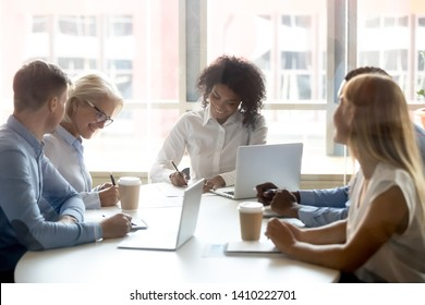 Signing contracts for services at group negotiations concept, diverse businesswomen seller and client company representatives partners making sale purchase business deal agreement at team meeting
