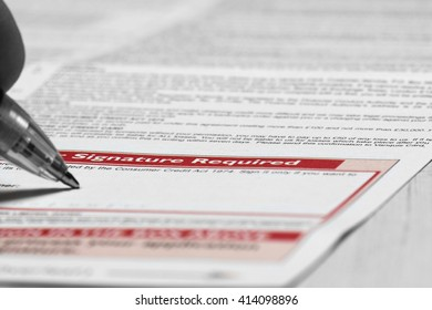Signing credit agreement / Man signing credit agreement form