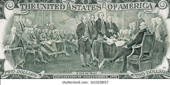 Signing declaration of independence at 4 of July 1776 on US two dollar bill. United States dollar close up.