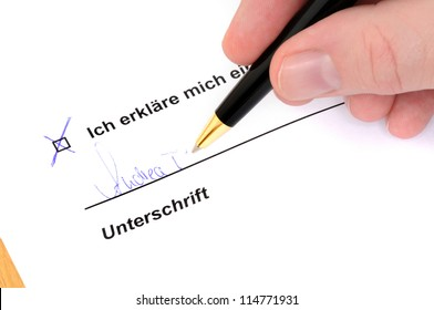 Signing a document with ballpoint pen Note for inspector: Self created document, no copyright