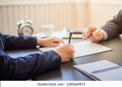 Signing of a home purchase and sale agreement after successful purchase of a home office, a real estate agent and signing a credit agreement agreement to buy a new home or rent an office property