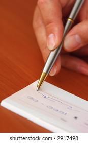 Signing money cheque