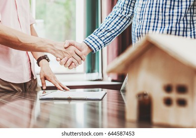 Signing of a real estate contract between buyer and broker.