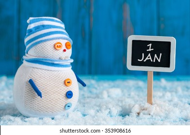 Signpost of the 1 January and two Snowman with red sled and gift stand near direction sign. Happy new year postcard.