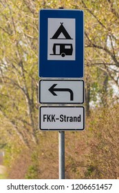 Signpost to campground, campsite and FKK beach