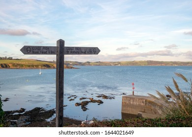 Signpost for the Cornish Coast Path on a peaceful autumn morning in Portscatho, Cornwall, UK