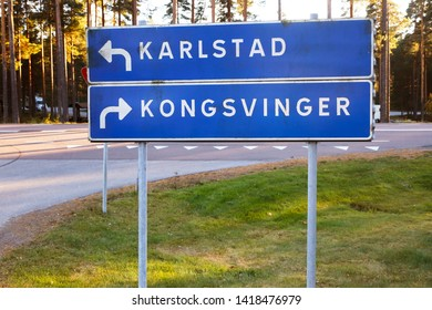 Signpost with direction to the Swedish city Karlstad and the Norwegian town Kongsvinger.