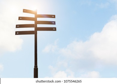 signpost guide direction sign on a pole with blue sky backgrounds