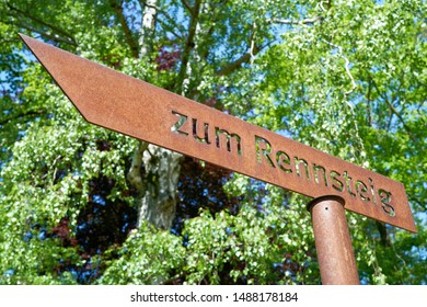 "Signpost to the hiking trail ""Rennsteig"" in Thuringia in Germany. The popular hiking trail is about 169 kilometers long."