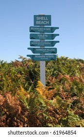 Signpost on beach on Herm