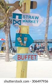 Signpost on a Caribbean island beach in the Bahamas.