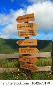 signpost on Faial Island (Azores, Portugal) next to the caldeira with cities and distances