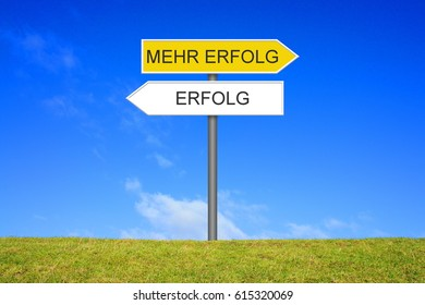 Signpost outside is showing Success and More Success in german language