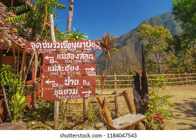 Signpost at Pha Bong View Point with Thai/English Text means same local, arrow left : to Mae Hong Son and Pai, arrow right : to Khun Yuam and Mae Sa Rieng District, all local in Mae Hong Son, Thailand