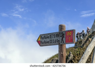 Signpost at Pico do Arieiro showing the hiking trail to Pico Ruivo, Madeira, Portugal