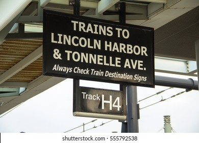 Signpost providing information on the Hudson ??Bergen Light Rail (HBLR) at the Hoboken Terminal in New Jersey, 2016.