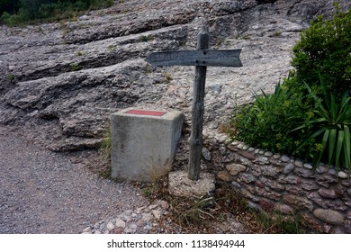 The signpost of the road to the top of the Montserrat mountain in the Pyrenees.
