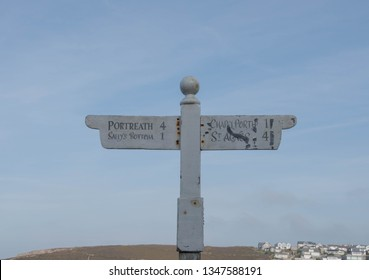 Signpost to St Agnes, Chapel Porth, Portreath and Sally's Bottom (A Disused Tin Mine) on the South West Coast Path in the Seaside Village of Porthtowan in Rural Cornwall, England, UK