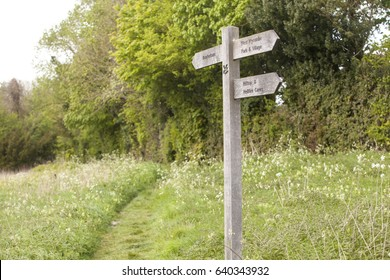 Signpost. Standard in the United Kingdom are nominated ancient walk paths, or rambling paths across farmlands. Signposts show the way to keep the walkers from wandering from the designated path.
