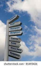 Signpost with timbuktu, azad.stary sacz, beighton, bydgosccz, cairns,  kampala, kezi,  Timbuktu