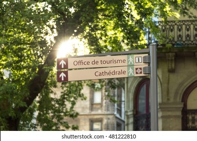 A signpost to the tourism office and the cathedral in Rouen, Normandie, France