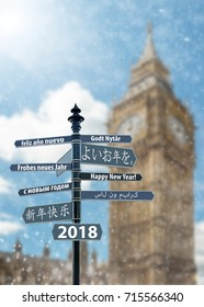 Signpost whit Happy New Year in many languages, Big Ben Clock Tower in background