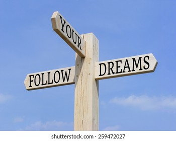 """Signpost with the words """"Follow Your Dreams"""" over a blue sky background"""