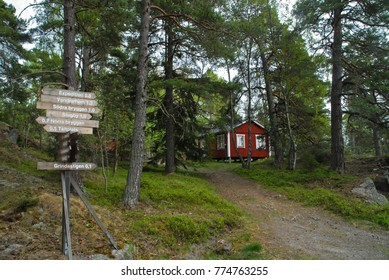 Signposts in front of red house on Grinda island near Stockholm